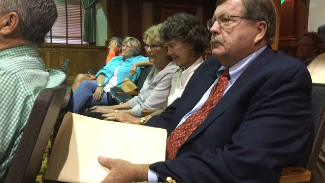 Fort Myers Beach attorney Bill Shenko waits to testify at Tuesday's Lee County Commission meeting where an agenda item to green-light Grand Resorts FMB's sea wall application was postponed due to public concern over a process that has left them out.