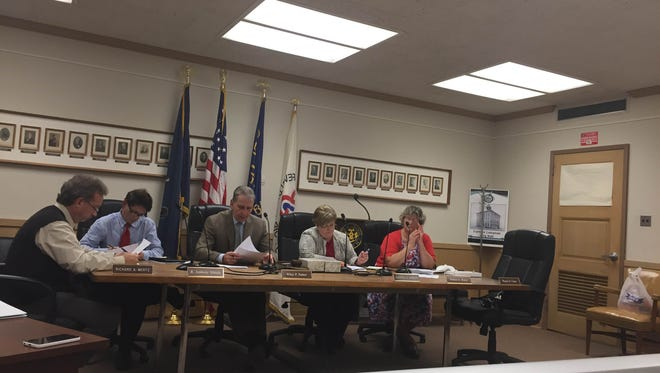 Lebanon City Council (from left) Richard Wertz, Tony Matula, Wiley Parker, secretary Cheryl Gibson and Pat Royer vote on raising some service fees Monday night. (Absent is Councilman Wayne Carey).