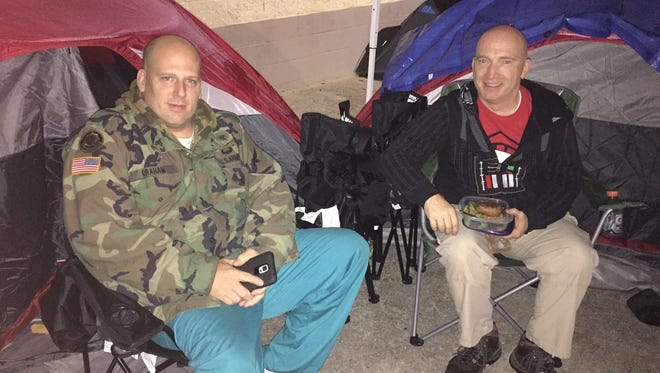 """Sean Graham, left, and Michael Miner are camping out in front of Carmike Bayou 15, and are the first in line for the first screening of """"Star Wars: The Force Awakens,"""" at 7 p.m. Thursday."""