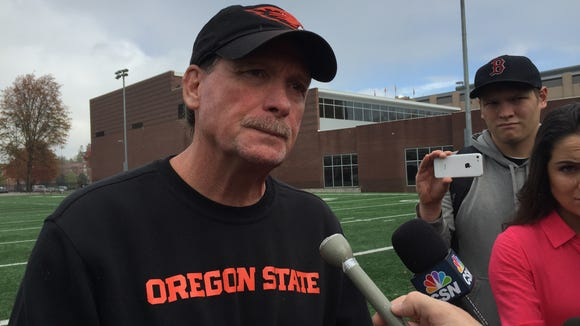 Oregon State assistant football coach Baldwin has moved from offensive coordinator to inside receivers coach.