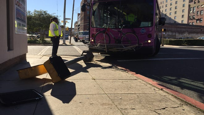 A Barksdale-bound bus driver toppled a crossing signal pulling out of the bus depot.