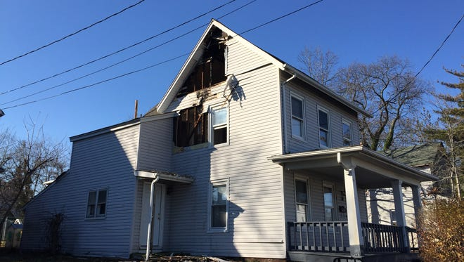 Fire damaged this Asbury Avenue home early Sunday morning and displaced seven people, according to Red Cross officials.