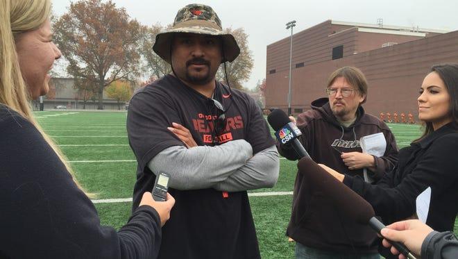 Former Oregon State defensive coordinator Kalani Sitake meets with reporters during the 2015 season.