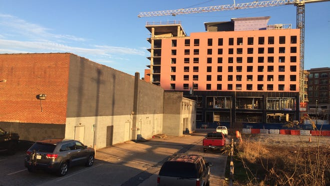 The property where a downtown visitors center had been planned is across River Street from where an Embassy Suites hotel is under construction.