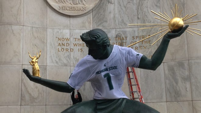 The Spirit of Detroit wears Michigan State's jersey for the first time.