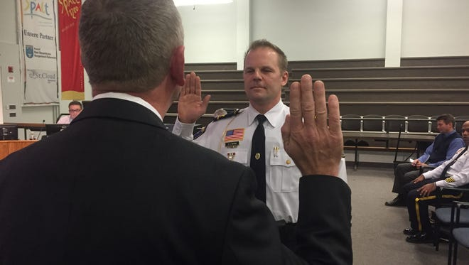 Jeff Oxton bring sworn in as assistant chief of the St. Cloud Police Department on December 21, 2015.