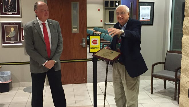 Mauldin Mayor Dennis Raines, left, presents a plaque to City Councilman Bob Cook before Cook's final City Council meeting Monday night.