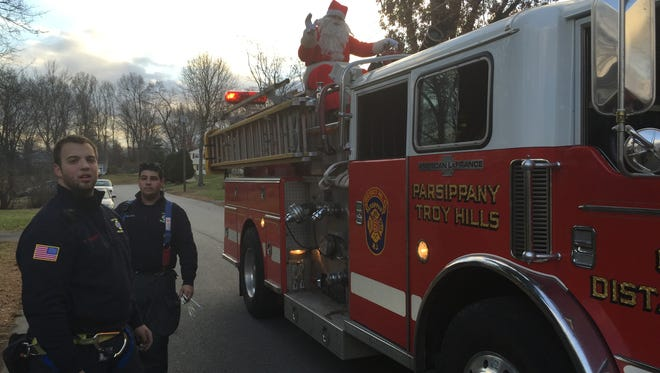 Volunteers from the Parsippany-Troy Hills Fire Department escort Santa around Parsippany.