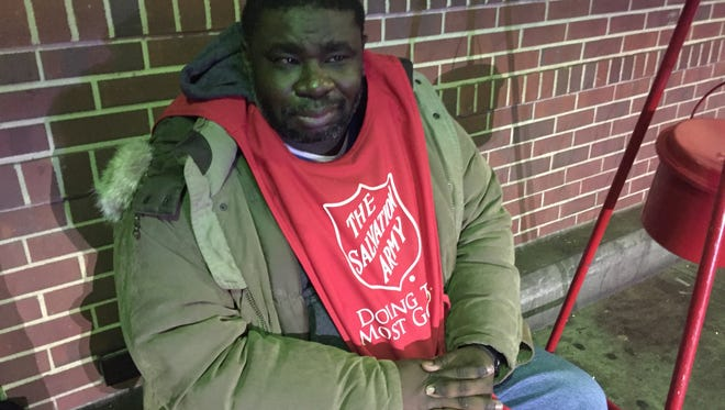 Salvation Army bell ringer Jermaine Simmons was back at work a few days after police said he was pummeled while waiting inside a Greenburgh Smashburger