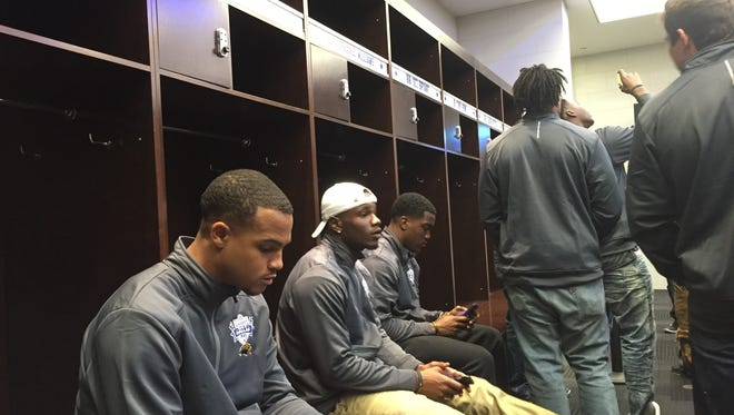 Southern Miss receivers, from left, D.J. Thompson, Mike Thomas and Korey Robertson take a seat inside the Dallas Cowboys locker room during a tour of AT&T Stadium Wednesday.