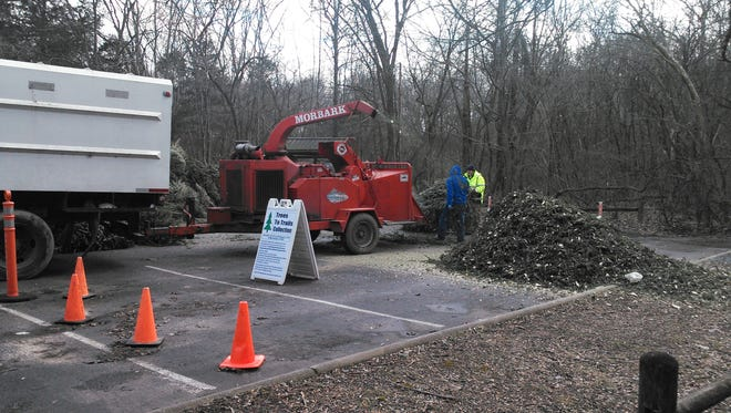 Clean Earth Collections donates their chipping services to process the Christmas trees dropped off at Radnor Lake State Natural Area for the park's Trees to Trails program.