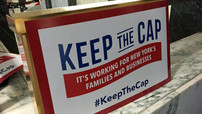 Business groups display a sign in Albany in 2015 in support of the tax cap