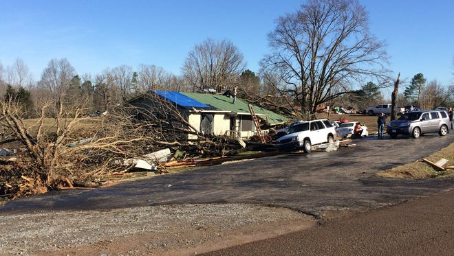 Residents of Falcon Road outside of Selmer are assessing damages this morning after Wednesday's storms.