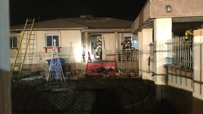 A house fire early Friday morning at a home in Phoenix displaced a family of four.
