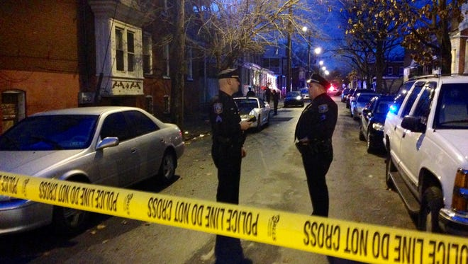 Police taped off West Third Street following a shooting that left one man with a gunshot wound to his leg.