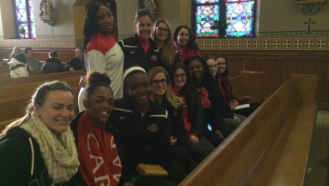 The Rutgers-Camden women's basketball team helped deliver food baskets at Sacred Heart Church.