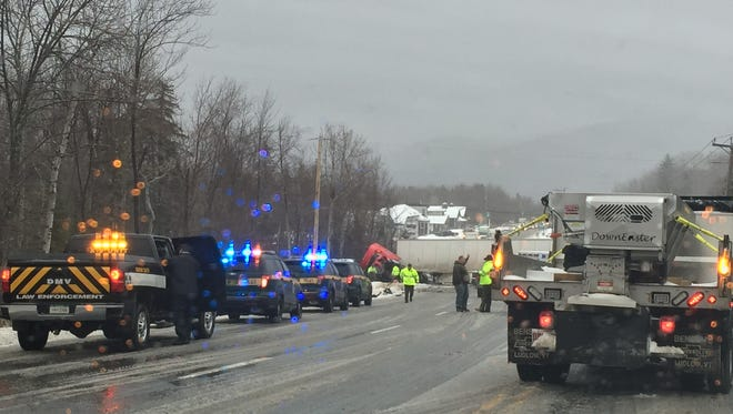 Emergency crews respond after a tractor trailer and an SUV collided Tuesday afternoon on U.S. 4 in Killington. Three people in the SUV were killed, the state police said.