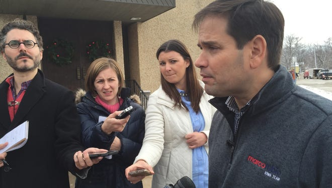 Sen. Marco Rubio, R-Fla., talks with reporters Tuesday after appearing at a town hall meeting in Clinton, Iowa.