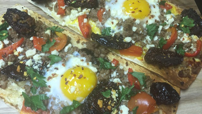 Turkish-inspired pizza that features a flatbread crust, seasoned ground lamb, red bell pepper, sun-dried tomatoes, Feta cheese and egg.