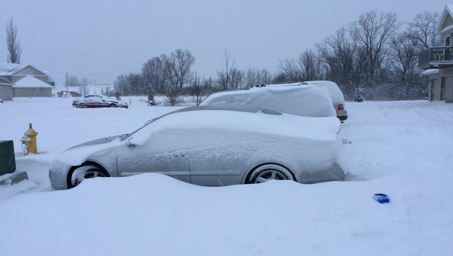 At Country Creek Estates in east Fond du Lac, vehicles were buried in snow and the estates' snowplow got stuck while plowing Tuesday morning.