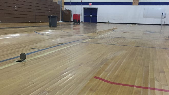 The gym floor of Pine Middle School is warped after flooding occurred over the Christmas holiday weekend.