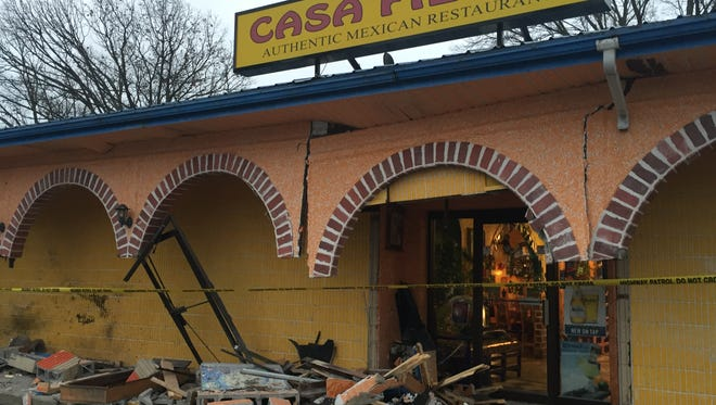 Casa Fiesta repairs began Thursday after debris spread throughout the parking lot after a single-vehicle crash Thursday morning.