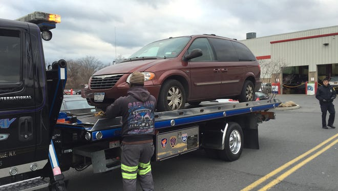 A minivan that police say struck a Rye Brook man in the Costco parking lot in New Rochelle during a road rage incident is towed, Dec. 31, 2015.  The Rye Brook man was treated at Montefiore New Rochelle Hospital and released. The minivan's driver, a Bronx resident, was charged with assault using a motor vehicle.