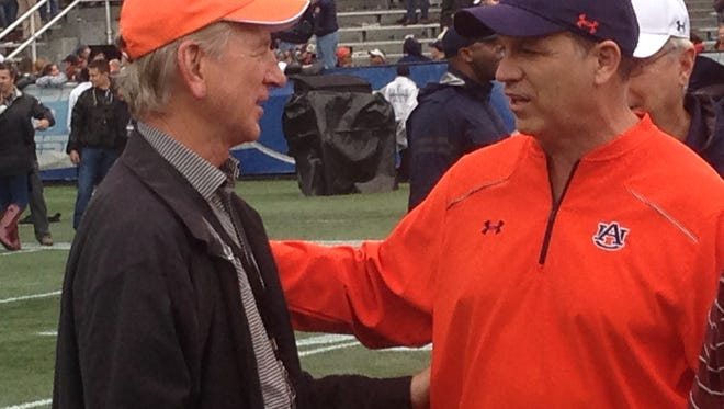 After a 31-10 victory in the Birmingham Bowl, Auburn interim defensive coordinator Lance Thompson is congratulated by former Auburn head coach Tommy Tuberville. Thompson announced Thursday he's joining Will Muschamp's staff at South Carolina.