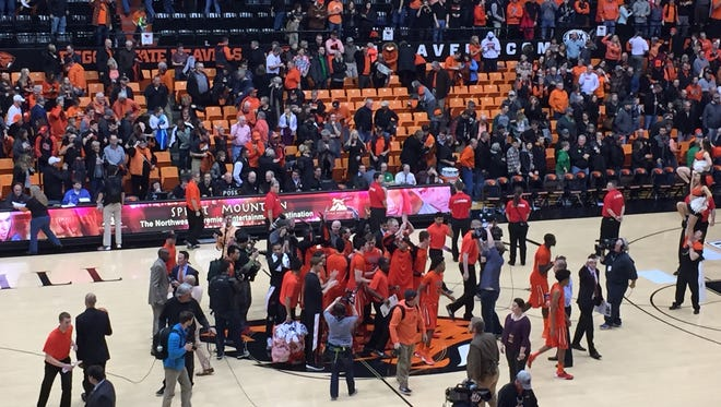 Oregon State players gather at mid-court after a 70-57 victory over Oregon at Gill Coliseum on Jan. 3, 2016.