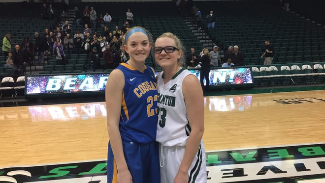 Misericordia freshman forward Rachel Carmody, left, poses with her twin sister and Binghamton Univeristy guard/forward Rebecca Carmody after Monday night's game in the Events Center.