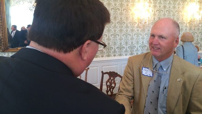 Jay Lucas of Hartsville, speaker of the South Carolina House, (foreground) greets former SC Rep. Rex Rice of Easley at the Poinsett Club in Greenville on Monday.