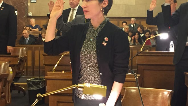 Margaret Cunzio takes her oath of office at the Board of Legislators organization meeting on Jan. 4, 2016.