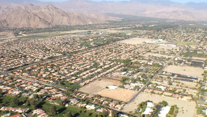 Green areas spread out across the Coachella Valley in this aerial photo, which was taken in 2013.