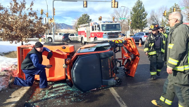 A sidewalk snowplow tipped onto its side Wednesday morning at the intersection of Taft Hill Road and Elizabeth Street in Fort Collins. Nobody was seriously injured, but traffic was blocked for about an hour.