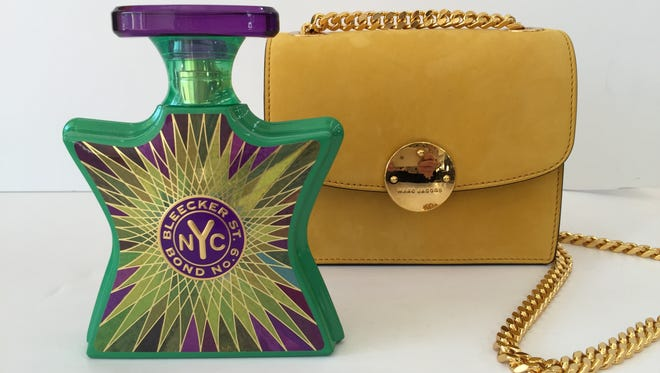 Bond No.9 and gold Marc Jacobs evening bag. Available at Kiki's.