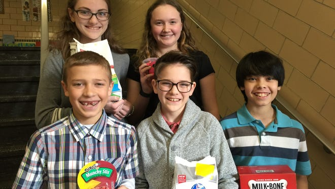 A group of St. Francis Middle School fifth- and seventh-graders recently worked to collect food, supplies and money for the Lakeshore Humane Society as part of their community service project. They collected more than $1,000 and donations of food, supplies, toys and bedding for the shelter. Pictured is, back row, Anna Heinzen and Paige Ewen. Front row is Brett Simmer, Ben Heinzen and Anthony Gauger.