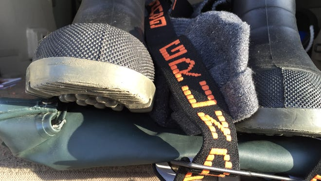 A pair of insulated deck boots, foul weather oil skins and a wool sweater will help keep you warm on the water in the winter.