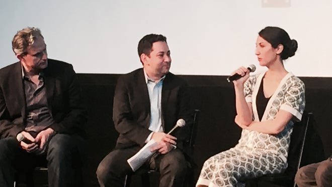 """Scott Feinberg (center) interviews French filmmaker Deniz Gamze Ergüven while Giulio Ricciarelli of Germany looks on at The Hollywood Reporter """"Eyes on the Prize"""" discussion at Palm Canyon Theatre"""