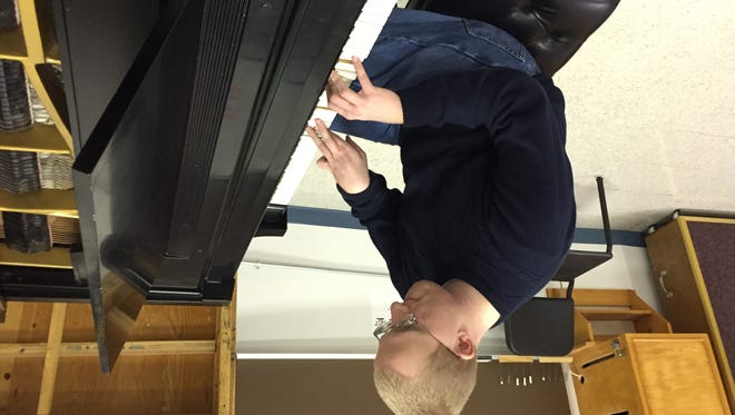 Lakeland College student Jacob Nault plays the piano using only six fingers due to a mild case of cerebral palsy.