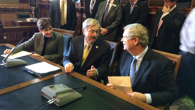U.S. Agriculture Secretary Tom Vilsack joins with Gov. Terry Branstad and Lt.  Gov. Kim Reynolds (right to left) for an announcement on water quality earlier this year.
