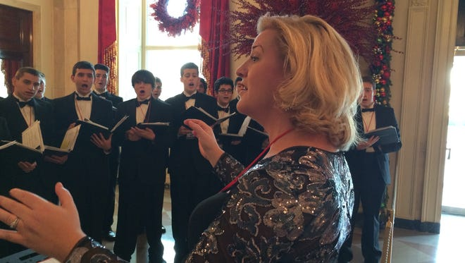 Choir director Nicole Snodgrass directs the Cherokee High School Concert Choir at the White House on Dec. 19.