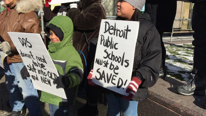 Two young sign holders demonstrate during a rally for teachers outside the Fisher Building in Detroit.