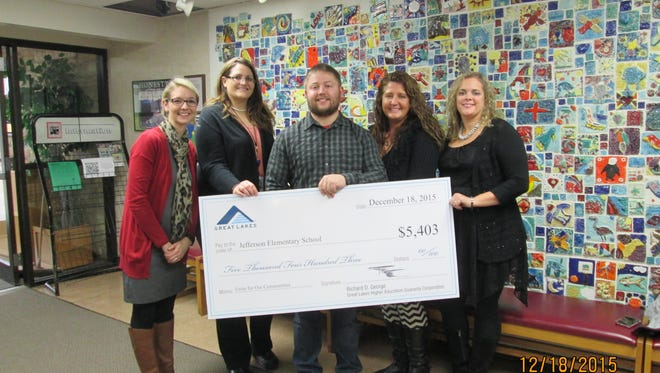 Great Lakes Higher Education Corporation presented a check for $5,403 to Jefferson Elementary School. From left: Principal Molly Demrow with Great Lakes employees Ashley Mansavage, Robert Allen, Jennifer Glad and Kristi Looze.