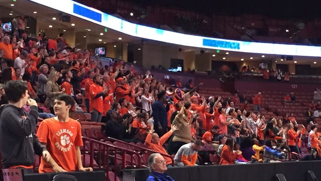 Clemson fans cheer at the Bon Secours Wellness Arena after a touchdown Monday.