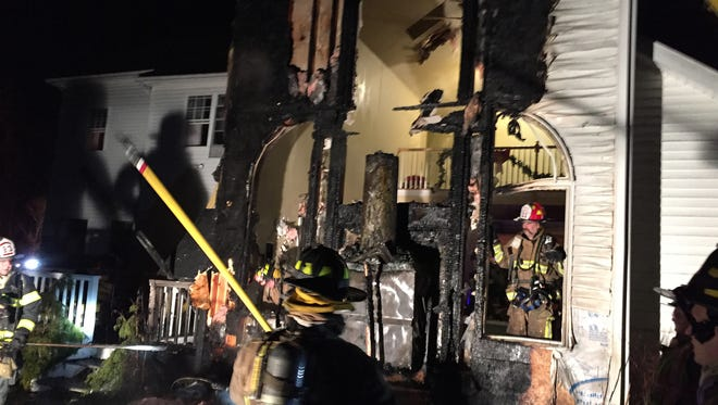 Brewster firefighters work at the scene of a house fire at 56 Carriage Hill Road in Southeast on Jan. 7.