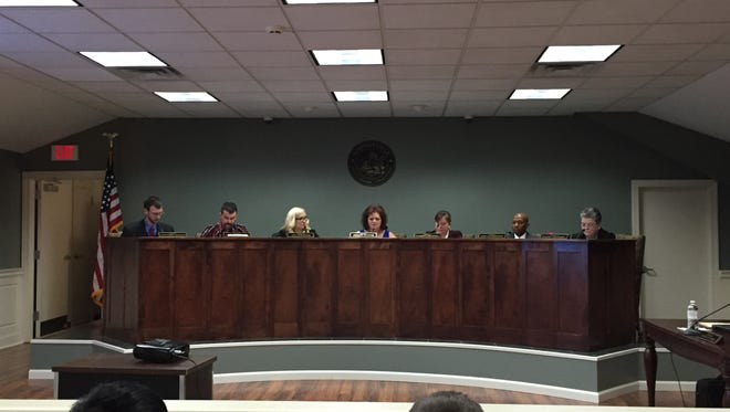 The newest edition of Simpsonville City Council, led by new Mayor Janice Curtis, center, met for the first time Tuesday at Simpsonville City Hall.