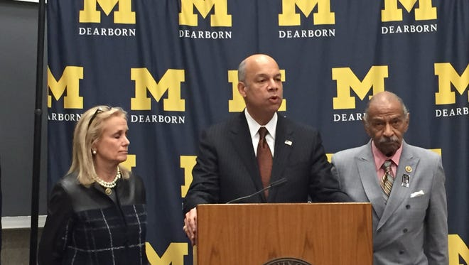 Secretary of Department of Homeland Security Jeh Johnson speaks at the University of Michigan-Dearborn, flanked by U.S. Reps. Debbie Dingell (D-Dearborn) and John Conyers (D-Detroit)