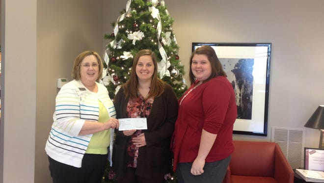 Spirit of Giving: The Bank of the Ozarks donated $250 to Gamma House. The Gamma House's goal is to provide a hand-up rather than a hand-out by creating an environment that enables women to find the tools they need to build a  successful and self-sufficient life for themselves and their children. Shown, from left, Myrna Killian,  branch operations manager, Sandy LaBahn, director at Gamma House, and Amanda Clark, teller/CSR.