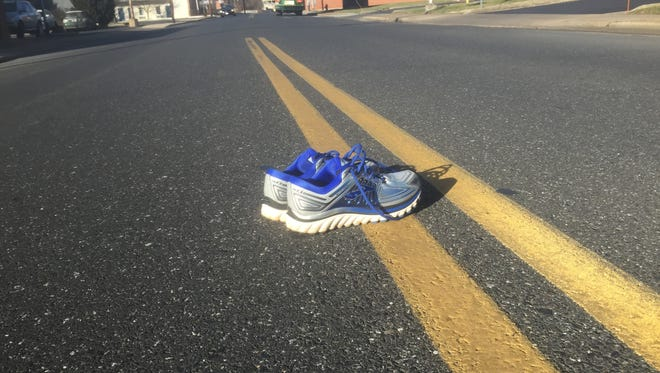 Running shoes and a road. All you really need to run.
