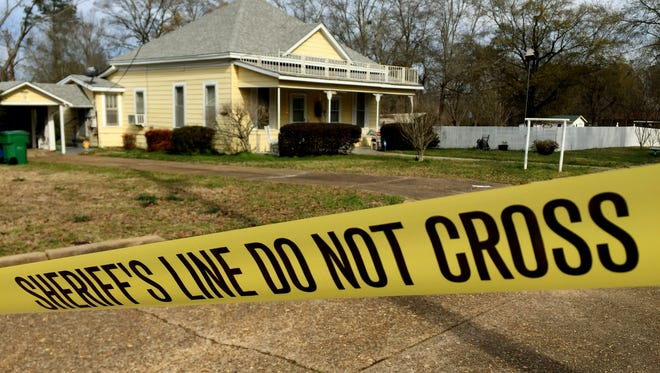 """The home of Sulyn Prince is surrounded by sheriff's tape as an investigation into her murder is still underway in Homer.  """"She was an angel from heaven"""" said neighbor Larry Hardy of Prince."""